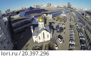 Купить «MOSCOW, RUSSIA - MAR 12, 2013: Church and car parking near Expo Center exhibition complex against cityscape at sunny day. Aerial view», фото № 20397296, снято 12 марта 2013 г. (c) Losevsky Pavel / Фотобанк Лори