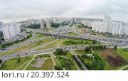Купить «Townscape with transport traffic on interchange at spring cloudy day. Aerial view», фото № 20397524, снято 28 мая 2014 г. (c) Losevsky Pavel / Фотобанк Лори