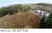 Купить «RUSSIA, MOSCOW – JUN 7, 2014: Football stadium Luzhniki with many people at festival of colours Holi. Aerial view. Photo with noise from action camera», фото № 20397532, снято 7 июня 2014 г. (c) Losevsky Pavel / Фотобанк Лори
