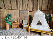 Купить «Interior of house made of bamboo, picture is made in rented public studio», фото № 20404144, снято 1 июня 2013 г. (c) Losevsky Pavel / Фотобанк Лори
