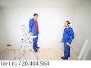 Купить «Two workers in blue clothes on ladder stand with construction tools in new apartment», фото № 20404564, снято 11 декабря 2013 г. (c) Losevsky Pavel / Фотобанк Лори