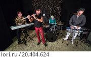 Купить «Musical band of four is working in studio with sand», фото № 20404624, снято 2 апреля 2014 г. (c) Losevsky Pavel / Фотобанк Лори