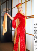 Купить «Young woman in red Andalusian costume stands in graceful pose», фото № 20405412, снято 7 мая 2014 г. (c) Losevsky Pavel / Фотобанк Лори