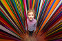 Beautiful little girl against the multi-colored ribbon labyrinth, фото № 20406096, снято 3 января 2014 г. (c) Losevsky Pavel / Фотобанк Лори