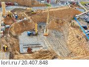 Купить «Foundation ditch with construction machinery at construction site, high angle view», фото № 20407848, снято 24 июня 2013 г. (c) Losevsky Pavel / Фотобанк Лори