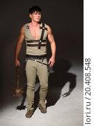 Купить «Strong young man in a costume holding mace in his hand», фото № 20408548, снято 14 апреля 2014 г. (c) Losevsky Pavel / Фотобанк Лори