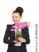 Beautiful woman in black suit holding artificial flower orchid, фото № 20408628, снято 7 июня 2014 г. (c) Losevsky Pavel / Фотобанк Лори