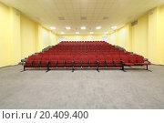 Купить «Small empty concert hall with red armchairs and yellow walls.», фото № 20409400, снято 17 августа 2013 г. (c) Losevsky Pavel / Фотобанк Лори