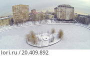 Купить «Small island on Egersky pond in winter cloudy day in Moscow, Russia, Aerial view», фото № 20409892, снято 3 декабря 2013 г. (c) Losevsky Pavel / Фотобанк Лори