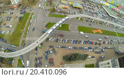 Купить «Crossroads of highways and railway with electric train near the telecentre, view from unmanned quadrocopter.», фото № 20410096, снято 23 октября 2013 г. (c) Losevsky Pavel / Фотобанк Лори