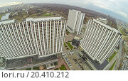 Купить «MOSCOW - OCT 21: Cityscape with tall multistorey Hotels in Izmailovo, housing Alpha, Beta and Gamma with car parking (view from unmanned quadrocopter) on October 21, 2013 in Moscow, Russia.», фото № 20410212, снято 21 октября 2013 г. (c) Losevsky Pavel / Фотобанк Лори