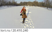Купить «Beautiful girl in a fur coat and shawl outdoor in the winter, view from unmanned quadrocopter», фото № 20410240, снято 17 января 2014 г. (c) Losevsky Pavel / Фотобанк Лори