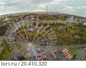 Купить «MOSCOW - OCT 22: View from unmanned quadrocopter to ferris wheel against Russian Exhibition Center and Ostankino on October 22, 2013 in Moscow, Russia.», фото № 20410320, снято 22 октября 2013 г. (c) Losevsky Pavel / Фотобанк Лори