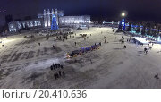 Купить «RUSSIA, SAMARA - JAN 6, 2014: View from unmanned quadrocopter to Kuibyshev Square with christmas tree in the evening. Is largest square in Europe.», фото № 20410636, снято 6 января 2014 г. (c) Losevsky Pavel / Фотобанк Лори