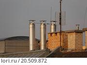 Купить «Roofs and chimneys», фото № 20509872, снято 15 ноября 2019 г. (c) PantherMedia / Фотобанк Лори