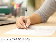 Купить «Woman hand writing or signing in a document», фото № 20513048, снято 19 ноября 2018 г. (c) PantherMedia / Фотобанк Лори