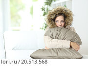 Купить «Woman warmly clothed in a cold home», фото № 20513568, снято 19 января 2019 г. (c) PantherMedia / Фотобанк Лори