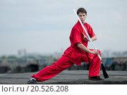 Купить «Shaolin warriors wushoo man in red with sword practice martial art outdoor. Kung fu», фото № 20526208, снято 10 августа 2011 г. (c) easy Fotostock / Фотобанк Лори