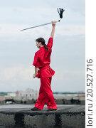 Купить «Shaolin warriors wushoo man in red with sword practice martial art outdoor. Kung fu», фото № 20527716, снято 10 августа 2011 г. (c) easy Fotostock / Фотобанк Лори