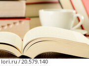 Купить «Composition with books and cup of coffee on the table», фото № 20579140, снято 19 ноября 2019 г. (c) easy Fotostock / Фотобанк Лори