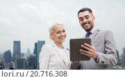 Купить «smiling businessmen with tablet pc in city», фото № 20716308, снято 19 августа 2014 г. (c) Syda Productions / Фотобанк Лори