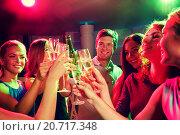 Купить «smiling friends with wine glasses and beer in club», фото № 20717348, снято 20 октября 2014 г. (c) Syda Productions / Фотобанк Лори