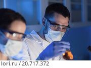 Купить «close up of scientists making test in lab», фото № 20717372, снято 4 декабря 2014 г. (c) Syda Productions / Фотобанк Лори