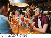Купить «happy friends with drinks talking at bar or pub», фото № 20717496, снято 7 мая 2015 г. (c) Syda Productions / Фотобанк Лори
