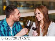 Купить «happy couple dining and drink wine at restaurant», фото № 20717572, снято 8 ноября 2015 г. (c) Syda Productions / Фотобанк Лори