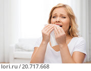 Купить «unhappy woman with paper napkin sneezing», фото № 20717668, снято 27 ноября 2015 г. (c) Syda Productions / Фотобанк Лори