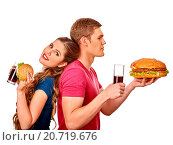 Купить «Man and woman eating big sandwich with cola. Isolated.», фото № 20719676, снято 15 октября 2015 г. (c) Gennadiy Poznyakov / Фотобанк Лори