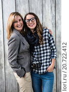 Купить «Mother and daughter smiling», фото № 20722412, снято 3 июля 2015 г. (c) Wavebreak Media / Фотобанк Лори