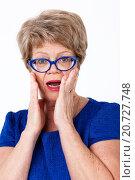 Купить «Портрет удивленной пожилой женщины на белом фоне», фото № 20727748, снято 13 декабря 2015 г. (c) Кекяляйнен Андрей / Фотобанк Лори