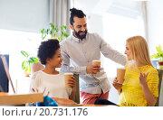 Купить «business team with coffee cups talking at office», фото № 20731176, снято 29 марта 2015 г. (c) Syda Productions / Фотобанк Лори