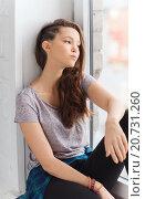 Купить «sad pretty teenage girl sitting on windowsill», фото № 20731260, снято 19 декабря 2015 г. (c) Syda Productions / Фотобанк Лори