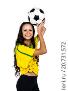 Купить «Smart supporting woman holding football», фото № 20731572, снято 28 мая 2015 г. (c) Wavebreak Media / Фотобанк Лори