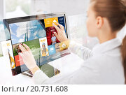 Купить «woman with web pages on touchscreen in office», фото № 20731608, снято 1 июня 2013 г. (c) Syda Productions / Фотобанк Лори