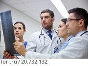 Купить «group of doctors looking at x-ray scan image», фото № 20732132, снято 3 декабря 2015 г. (c) Syda Productions / Фотобанк Лори