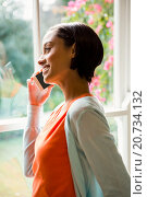 Купить «Smiling brunette on a phone call», фото № 20734132, снято 15 июля 2015 г. (c) Wavebreak Media / Фотобанк Лори