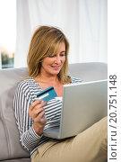 Купить «Woman paying on internet», фото № 20751148, снято 3 июля 2015 г. (c) Wavebreak Media / Фотобанк Лори