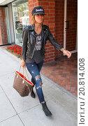 Купить «Pussycat Dolls founder, Robin Antin wearing a Saint James Band t-shirt and black leather bikers jacket, goes shopping in Beverly Hills carrying a Yves...», фото № 20814008, снято 14 апреля 2015 г. (c) age Fotostock / Фотобанк Лори