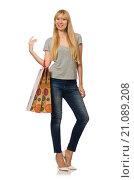 Купить «Woman with shopping bags isolated on white», фото № 21089208, снято 8 октября 2015 г. (c) Elnur / Фотобанк Лори