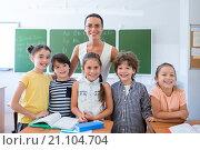 Купить «Pupils with teacher», фото № 21104704, снято 21 августа 2015 г. (c) Raev Denis / Фотобанк Лори