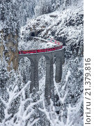 Купить «Bernina Express train passes on Landwasser Viadukt Filisur Canton of Graubünden Switzerland Europe.», фото № 21379816, снято 22 февраля 2019 г. (c) age Fotostock / Фотобанк Лори