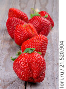 Купить «Big Fresh Ripe Strawberries closeup on Rustic Wooden background», фото № 21520904, снято 19 мая 2014 г. (c) easy Fotostock / Фотобанк Лори
