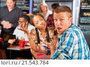 Купить «Embarrassed Caucasian man with young woman in cafe», фото № 21543784, снято 16 ноября 2013 г. (c) easy Fotostock / Фотобанк Лори