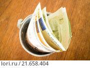 Купить «International currencies bank note in the bucket», фото № 21658404, снято 16 июня 2019 г. (c) PantherMedia / Фотобанк Лори