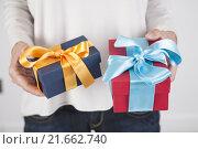 Купить «two gifts in woman hands», фото № 21662740, снято 22 ноября 2017 г. (c) PantherMedia / Фотобанк Лори