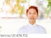 Купить «Handsome man practicing thai chi», фото № 21674712, снято 19 декабря 2014 г. (c) Sergey Nivens / Фотобанк Лори