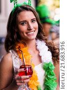 Купить «Portrait of woman celebrating St Patricks day», фото № 21683916, снято 25 сентября 2015 г. (c) Wavebreak Media / Фотобанк Лори